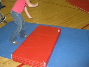 Teach students cartwheels with helper mats